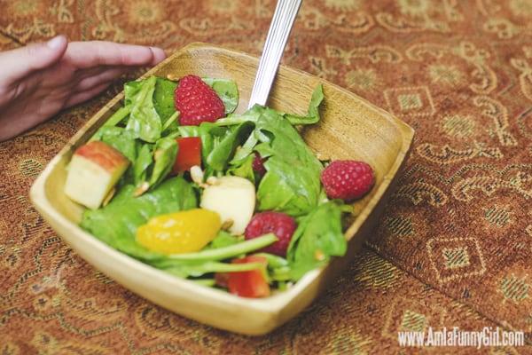 #FreshFinds Kid grabbing spinach salad #shop
